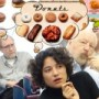 Photo of professors with thought bubbles of donuts