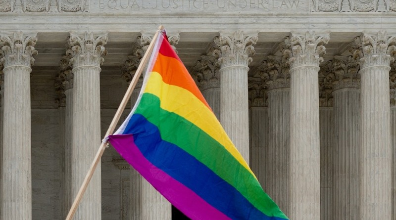 Photo of gay pride flag in front of Supreme Court building