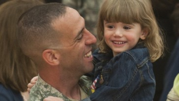 Photo of soldier and daughter