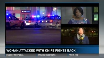 Television screen of a news report about a woman who fought off an attacker